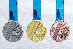 The designs for the medals to be awarded at the upcoming Winter Youth Olympic Games have been unveiled ©Lillehammer 2016 Lillehammer, Olympic Winners, Youth Olympic Games, Trophies And Medals, Trophy Design, Olympic Medals, Challenge Coins, Coin Jewelry, Sports Day