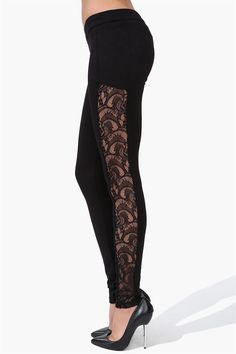Ballet Lace Legging in Black A fun girly pair of leggings! These leggings have lace overlay/cut out at outside of each leg. These tight fitting leggings have single elastic band at waist for comfort and fit. Wear with metallic over sized sweater.
