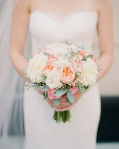Life in Bloom created this bride's bouquet of garden roses, spray roses, dahlias, seeded eucalyptus, ranunculus, and tweedia for her Chicago wedding.