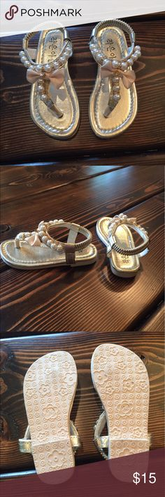 Toddler sandals Super cute size 6.5 or 7 toddler sandals. These are gold with pearls, rhinestones and a cute bow! Box included. Shoes Sandals & Flip Flops