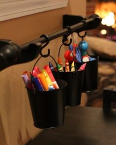 Organizing tip- hang curtain rod, add s-hooks and hang cups with pens, crayons, etc.  Clever!