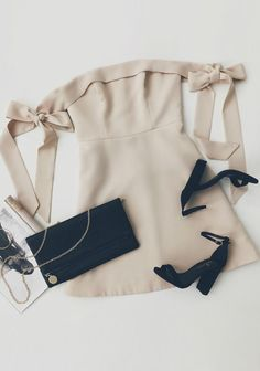 White and airy off the shoulder dress with matching dark blue sandals and purse
