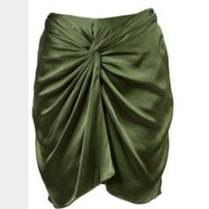 Elizabeth and James Silk Skirt in Olive Beautiful olive skirt in a luxurious fabric. The hue is so neutral, and can be worn with a simple black or white tank and any color shoe! Versatile! Color is more like the first through third pics, last was standing directly under a light. Elizabeth and James Skirts