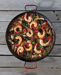 Paella Mixta (Mixed Paella)-- This over-the-top Americanized paella gets its smoky kick from paprika and chorizo.