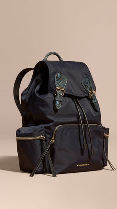 A lightweight showerproof rucksack with cushioned and polished metal chain shoulder, inspired by the fabric of the Burberry trench coat.