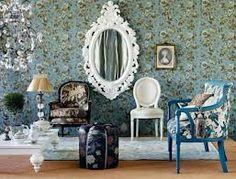 Blue vintage love seat. White painted vintage mirror.