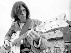 December San Diego, California, USA --- Neil Young plays his vintage Gretsch White Falcon during a sound check at Balboa Stadium just before a Crosby, Stills, Nash & Young concert. --- Image by © Henry Diltz Neil Young, Young Young, Young Black, Gretsch, Henry Diltz, San Diego, San Francisco, Folk Rock, Crosby Stills & Nash