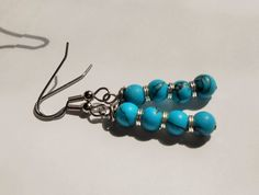HandMade beaded turquoise colored earrings / by TheYellowHouse39, $5.00
