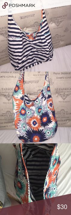 Crossbody reversible sling Reversible thirty one cross body sling. Blue and white stripped pattern/blue orange and white floral pattern. Two large inner pockets and two large outer pockets. Great for school! Thirty one Bags Crossbody Bags