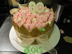 """80th birthday cake using the """"Duff method"""" for fondant roses.  The picket fence is fondant tinted brown (the fence needs several days to dry)."""