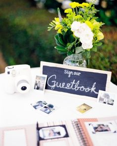 Polaroids were artfully placed in a scrapbook at this real wedding to be kept as a beautiful memento from the day