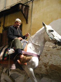 Moroccan man on horse - Fes Medina