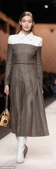 Trio in tweed! Gigi and Bella Hadid join Kaia Gerber as they storm the runway for Fendi at...
