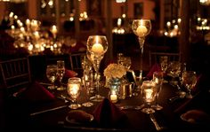 Wedding centerpiece with floating candle and flowers except with pearls in the bottom instead of glass. Description from pinterest.com. I searched for this on bing.com/images