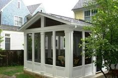 Sunroom Addition Design Ideas, Pictures, Remodel and Decor Really like the panel detail and the extra detail on the columns. Looks classy. Patio Set, House With Porch, Remodel, Porch Design, Sunroom Addition, Porch Remodel, Porch Kits, Three Season Porch, Building A Porch