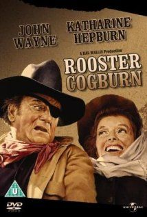 Rooster Cogburn (1975) Marshal Rooster Cogburn (Wayne) unwillingly teams up with Eula Goodnight (Hepburn) to track down the killers of her father.