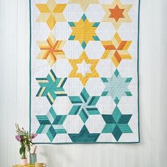 Get clever with traditional piecing and twist simple triangles into this striking star quilt! @brownbirddesigns' Falling Stars pattern is exclusively in issue 88 – grab a copy through the link in our bio! | Fabric: Riley Blake Designs Confetti Cotton Modern Quilt Blocks, Modern Quilting, Falling Stars, Riley Blake, Star Patterns, Triangles, Confetti, Clever, Traditional