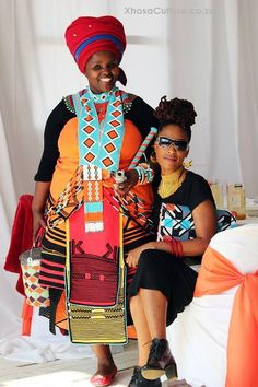 Jessica Mbangeni (left) is South Africa's only female Imbongi (praise poet) - here dressed in traditional Xhosa outfit. Xhosa Attire, African Attire, African Wear, African Women, African Dress, African Traditional Wedding, African Traditional Dresses, Traditional Outfits, African Print Fashion