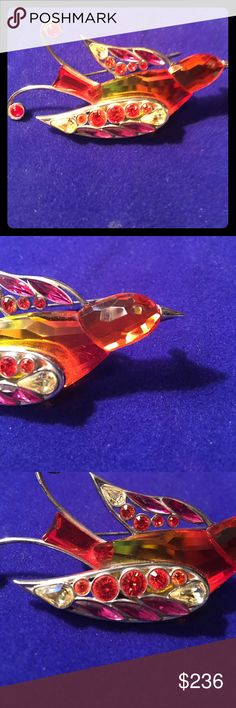 Daniel Swarovski Bird of Paradise Sterling silver with tangerine,plum red, and citrine colored crystals Swarovski Jewelry Brooches