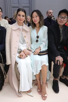 Camila Coelho and Aimee Song attend the Chloe show as part of the Paris Fashion Week Womenswear Fall/Winter 2017/2018 on March 2 2017 in Paris France
