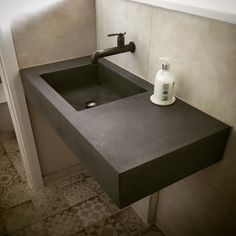 Polished concrete floating vanity sink worktop made from polished concrete installed in London by concrete Tuesdays