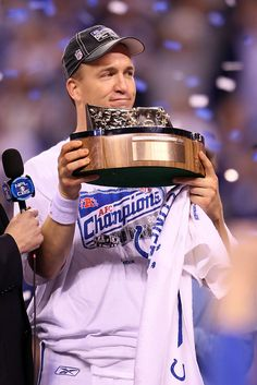 INDIANAPOLIS - JANUARY Quarterback Peyton Manning of the Indianapolis Colts holds the Lamar Hunt trophy after the Colts defeated the New York Jets to win the AFC Championship Game at Lucas Oil Stadium on January 2010 in Indianapolis, In Pro Football Teams, Denver Broncos Football, Alabama Football, Pittsburgh Steelers, College Football, Dallas Cowboys, Peyton Manning Pictures, Peyton Manning Colts, Drew Bledsoe
