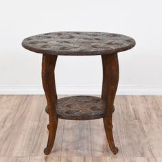This two-tier side table is featured in a solid wood with a distressed maple finish. This end table is in great condition with carved floral motifs throughout, cabriole legs, and two round table tops. Great for holding books, drinks, and more! #traditional #tables #endtable #sandiegovintage #vintagefurniture