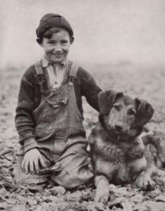 1930's photo illustration Boy and Dog Shepherd Dog black and white photo.