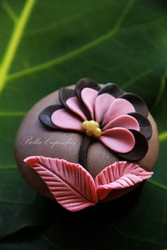 Bella Cupcakes - pink and black fondant petals with pink leaves on a chocolate covered cupcake