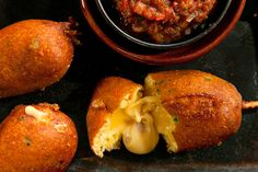Jalapeño-Cheese Corn Dogs Recipe_This Vegetarian twist on the corn dog, with melty pepper jack cheese and a crispy jalapeño-laden crust, has flavors reminiscent of Chiles Rellenos and far surpasses boring fried mozzarella sticks served with marinara sauce. Try dipping these snacks in spicy Roasted Tomato Salsa for a little Tex-Mex flair.
