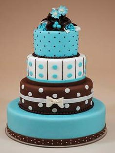 Four tier chocolate brown and blue polka dot fondant wedding cake