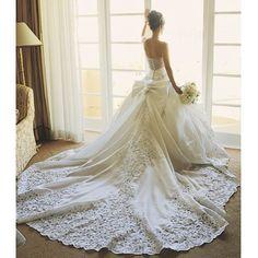 Impressive train on this #realbride's @stpucchi #wedding gown (Photo by @yitzhakdalalphotographer, floral design by @marksgarden) - insideweddings's photo on Instagram