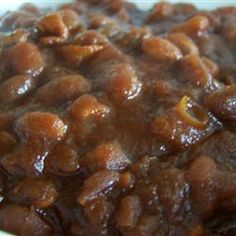 Slow Cooker Homemade Beans    3 cups dry navy beans, soaked overnight   1 1/2 cups ketchup   1 1/2 cups water   1/4 cup molasses   1 large onion, chopped   1 tablespoon dry mustard   1 tablespoon salt   6 slices thick cut bacon, cut into 1 inch pieces   1 cup brown sugar  Drain soaking liquid from beans Stir ketchup, water, molasses, onion, mustard, salt, bacon, and brown sugar into the beans until well mixed Cover, and cook on LOW for 8 to 10 hours, stirring occasionally