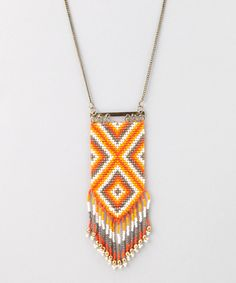 Peyote Fringe Necklace - Since jewelry is a common conversation piece and an extension of your personal style, it's your prerogative to be picky. We think this fabulous fringe necklace will surpass your scrutiny with its colorful beads and Southwestern style. Treat yourself to this eclectic accessory straight out of India and bask in your countless compliments. •32'' long •Seed bead / base metal •Imported