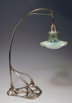 Art Nouveau table lamp, 1902, attributed to Friedrich Adler, silver-plated bronze, floriform cased glass shade.:
