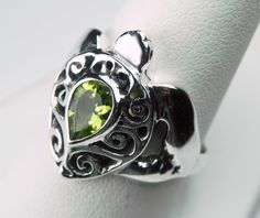 Turtle Ring - Sea Turtle Ring - Sterling Silver Peridot Ring - Unique Sea Turtle Jewelry - Ocean Inspired - Pea Green August Birthstone. $114.00, via Etsy.