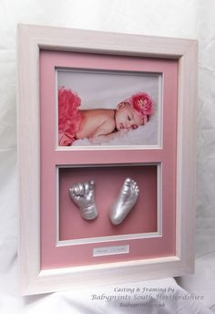 A stunning photo with hand & foot casts in pearly white in a limed wax finish hardwood frame. By Babyprints.co.uk