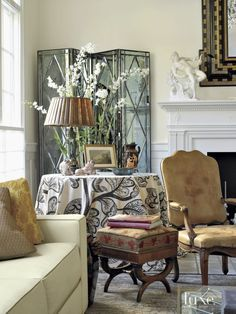 A mirrored screen from the provides the backdrop for a classic vignette in the living room. Cream Living Rooms, Home Living Room, Living Room Designs, Living Room Decor, Living Spaces, Beautiful Living Rooms, Beautiful Interiors, Interior Decorating, Interior Design