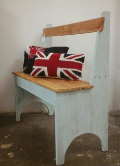Colour washed pallet bench seat and knitted flag cushions