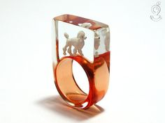 Happy curls – unique poodle ring with a white poodle on a red ring in resin for dog lovers