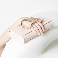 zaha hadid design brings out sculpted glove clutch for perrin paris