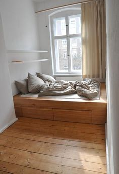Small spaces again. Another Berlin-based carpenter -- a friend has worked with her. Also, love how they've hung the curtains.