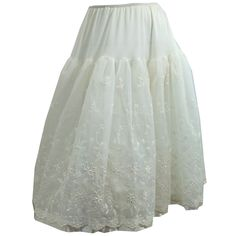 "1960s nylon and taffeta crinoline with eyelet lace, layered over tulle. No flaws. Measures 24-28"" waist, 50"" hips, 26"" long"