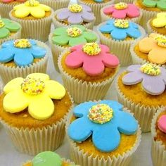Colorful cupcakes via cakealicious