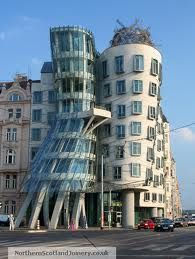 Dancing House - Frank Gehry/Vlado Milunc Architects.  1992-1996.  Prague, Czech Republic. Built on the riverfront in an historic area of Prague.  Top floor houses a restaurant open to the public.