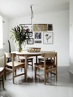 remain simple. LOVE this table & chairs & picture display on wall