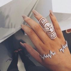 This color is similar to what I'm wearing! Intriguing ring!!!