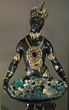 "Scanned from a National Geographic Magazine from the late 1970's. I remember this image intensely. I've been searching for it on the internet for years. I just found it. ""Blackamoors"" such as this were a favorite artistic device in the Baroque era, whether sculpted or painted. This lavish example was created in Dresden, I believe. The body is ebony accentuated with solid gold jewelry and precious gems. The Blackamoor carries a platter of raw emeralds.  SUPERB !"