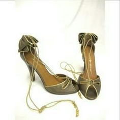 1hr!HPMiss 60's~high heels w/gold ties Make me an offer! Miss 60 Italian high heels w/golden straps & bows on back heel.  Very versatile in u choose how 2 tie them up (roman style or regular). double loop over ankle looks amazing. They have metal at the end of ties that make a slight sound when walking.  only slightly worn. likely store sample shoes or returns.. One scuff side, pic 2. Price tag shows $219. Size 9 tho I think it runs small? Sized 9.  8 1/2 might work if you do not require…