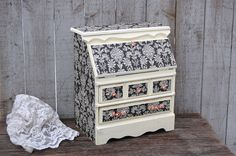 Upcycled vintage jewelry box, drop front secretary style. Wood, hand painted in a soft ivory with decoupage of black and ivory damask, very lightly distressed and finished with a protective clear coat